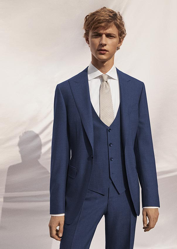blue-three-piece-suit-with-metallic-bow-tie