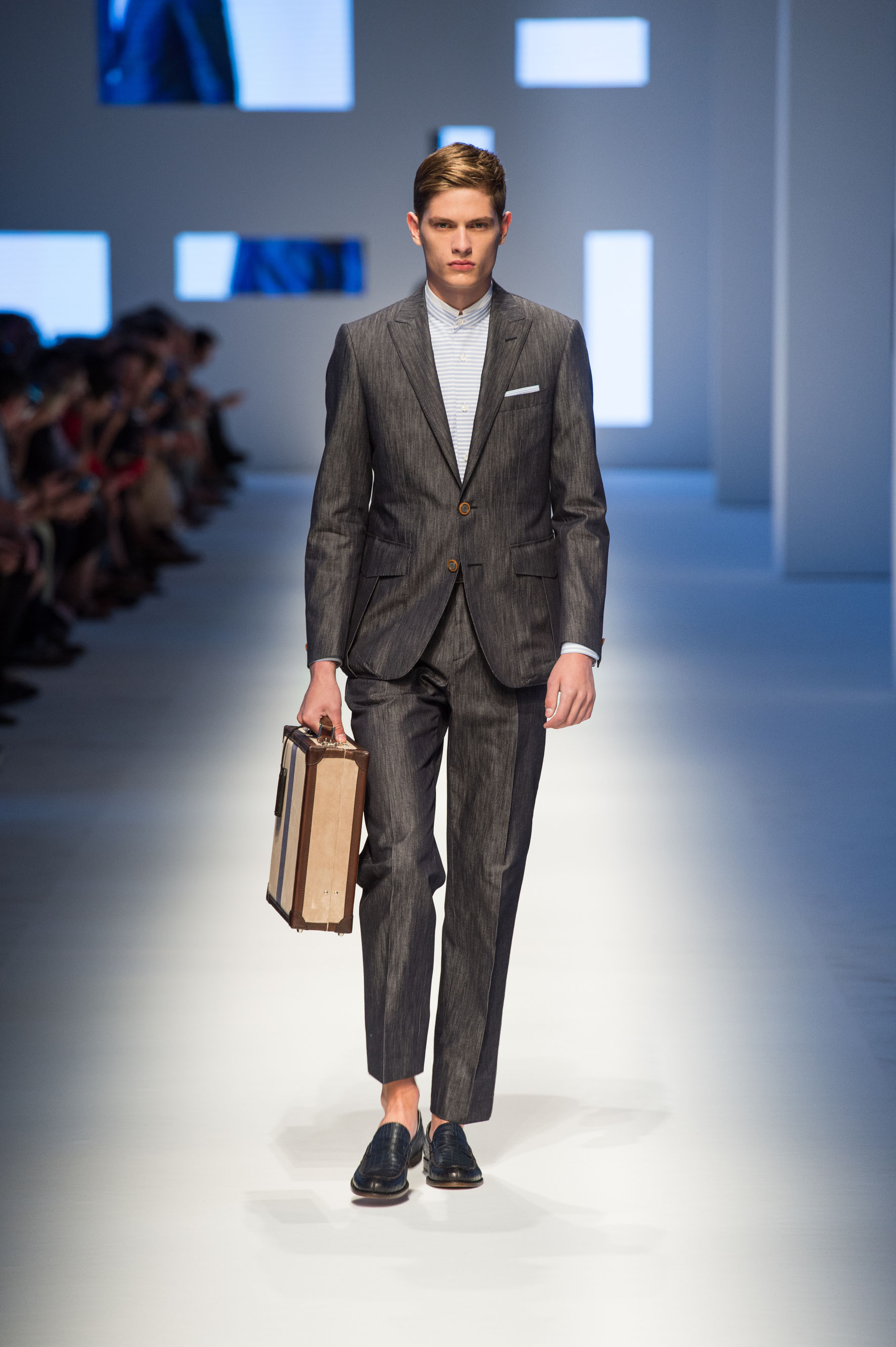 Silk blend denim suit with applied bellows pockets, crocodile loafers and briefcase with contrast color stripe