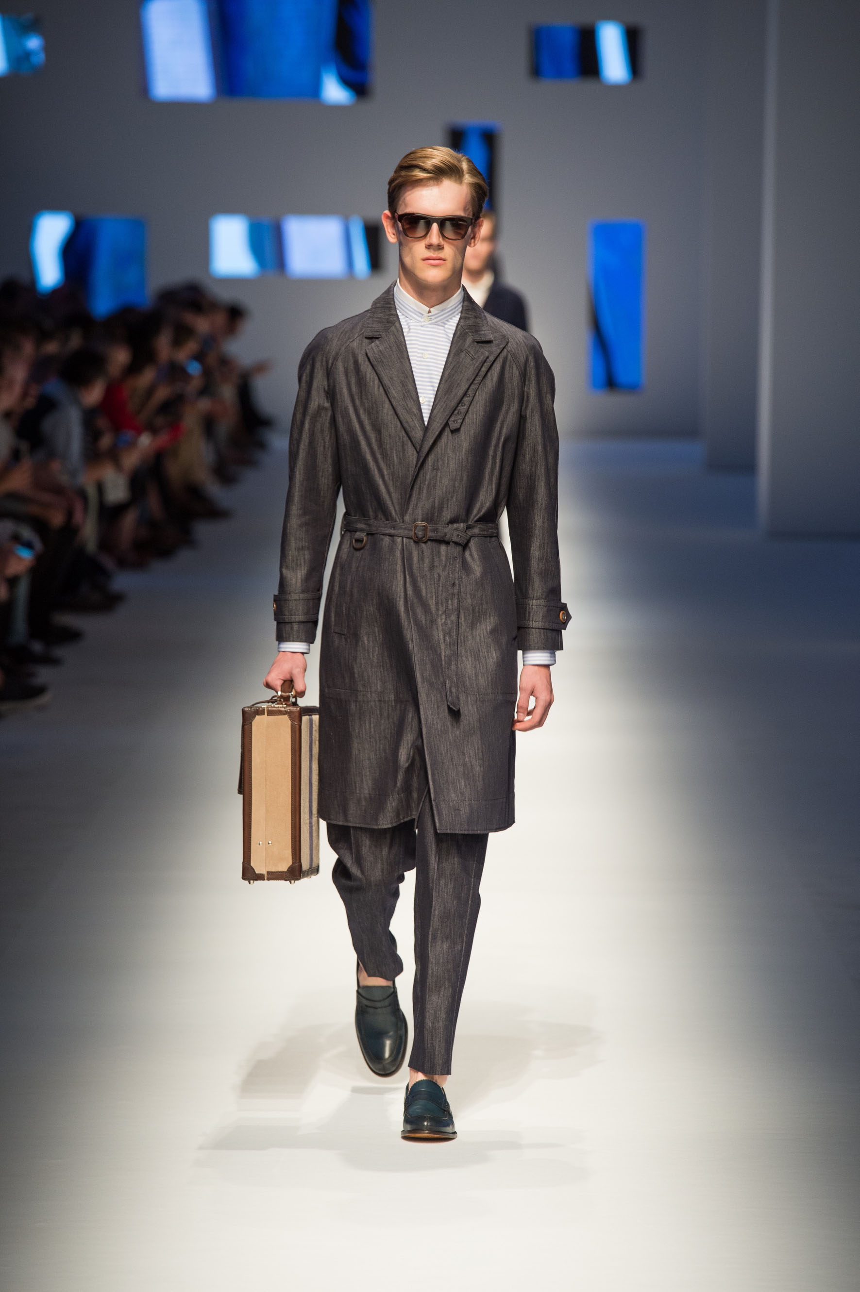 Unlined rain coat in silk blend denim with belt, loafers in shaded calfskin, briefcase with contrast color stripe
