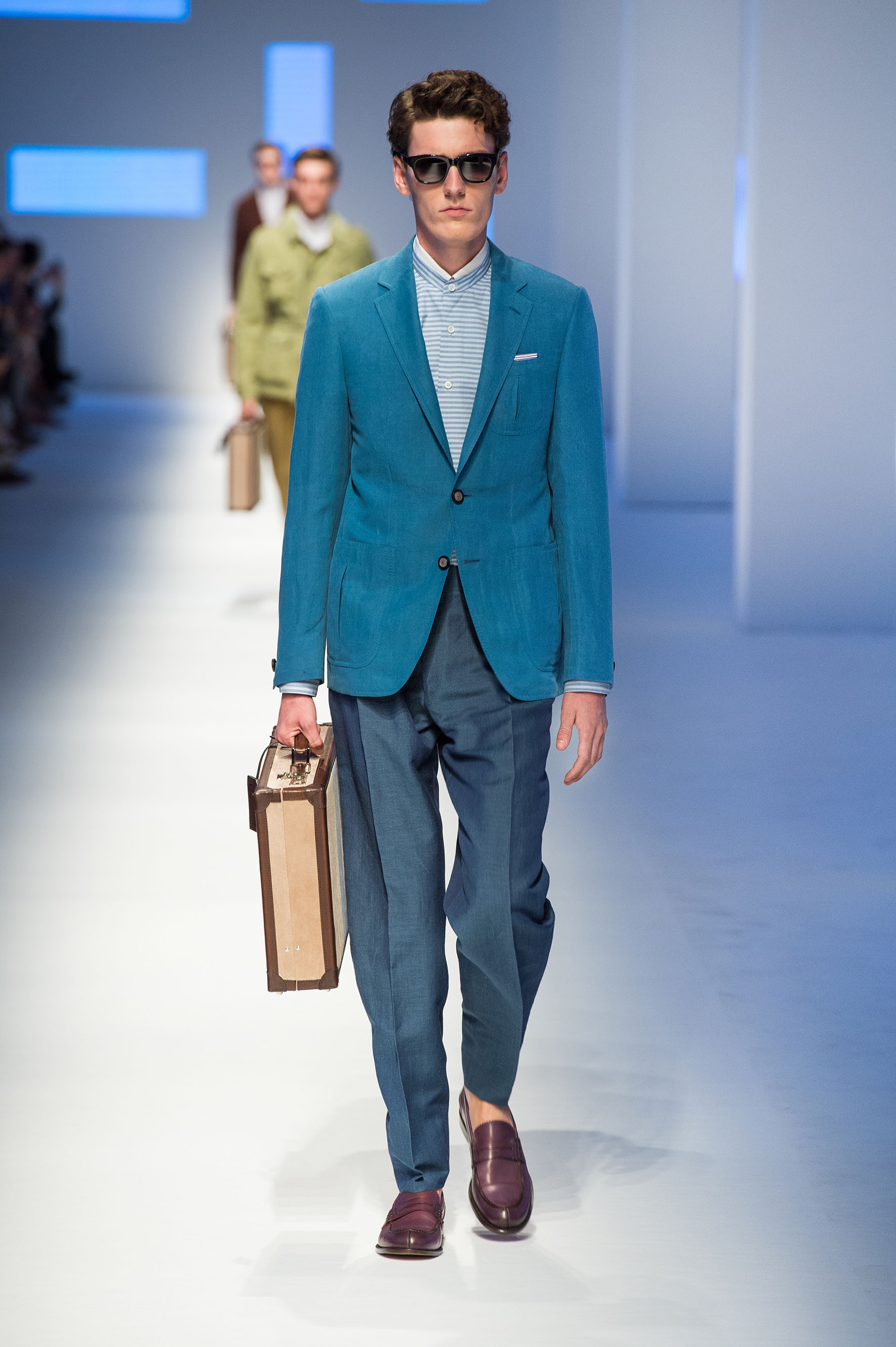 Linen-silk two button jacket with bellows pockets, reverse-pleated pants, calfskin loafers, briefcase with stripe