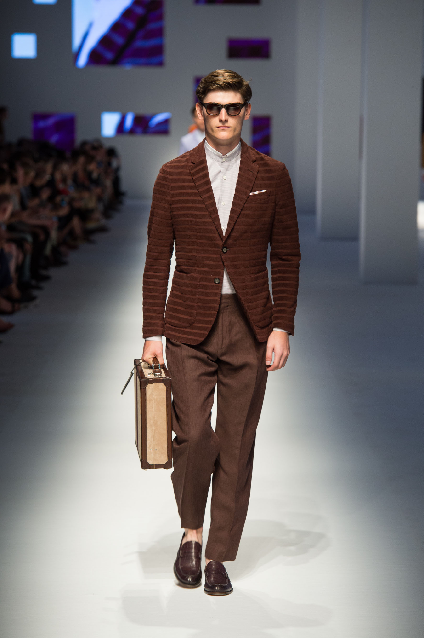 Two-button jacket with terry effect stripes, reverse-pleated linen-silk pants, crocodile loafers, briefcase with stripe