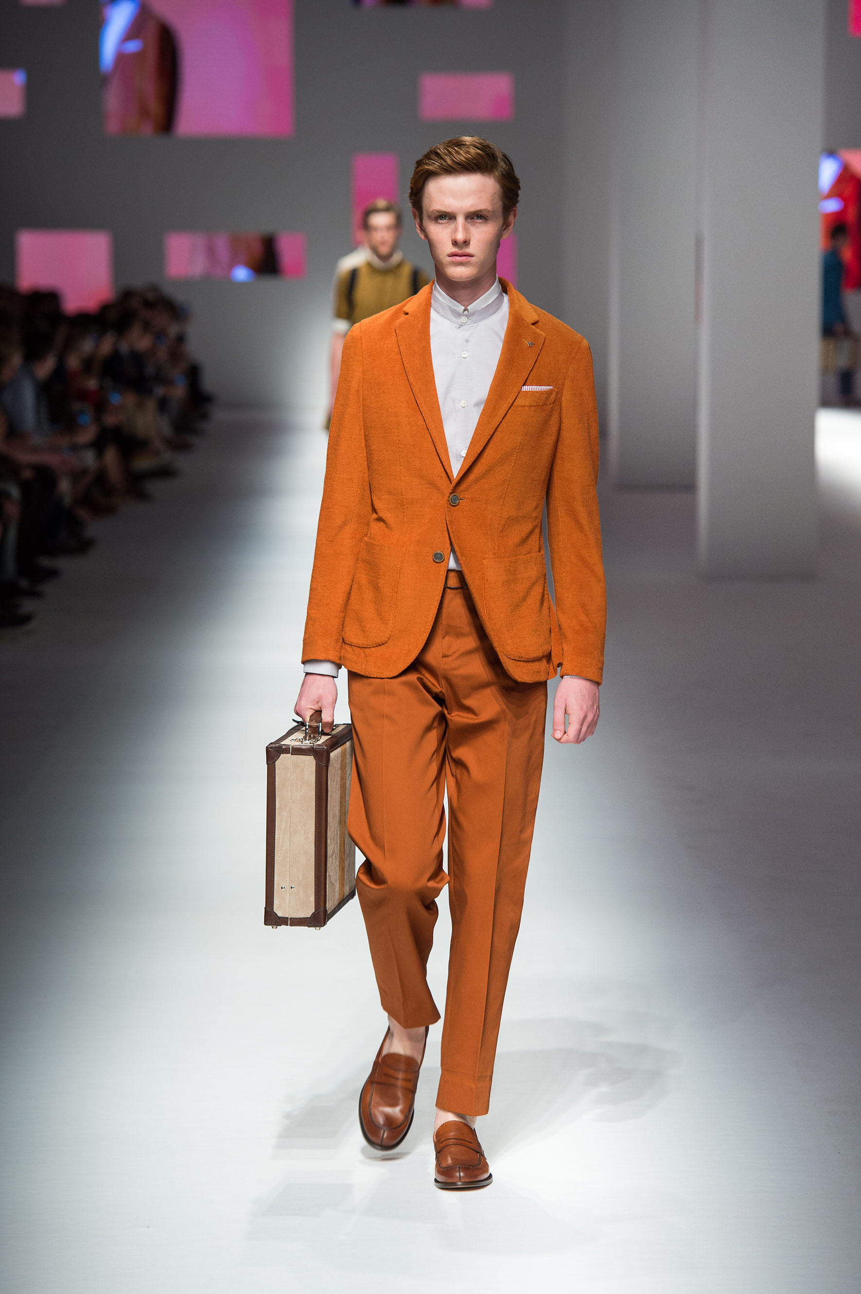 Two-button jacket with terry effect stripes, pants with removable belt, calfskin loafers, briefcase with contrast stripe