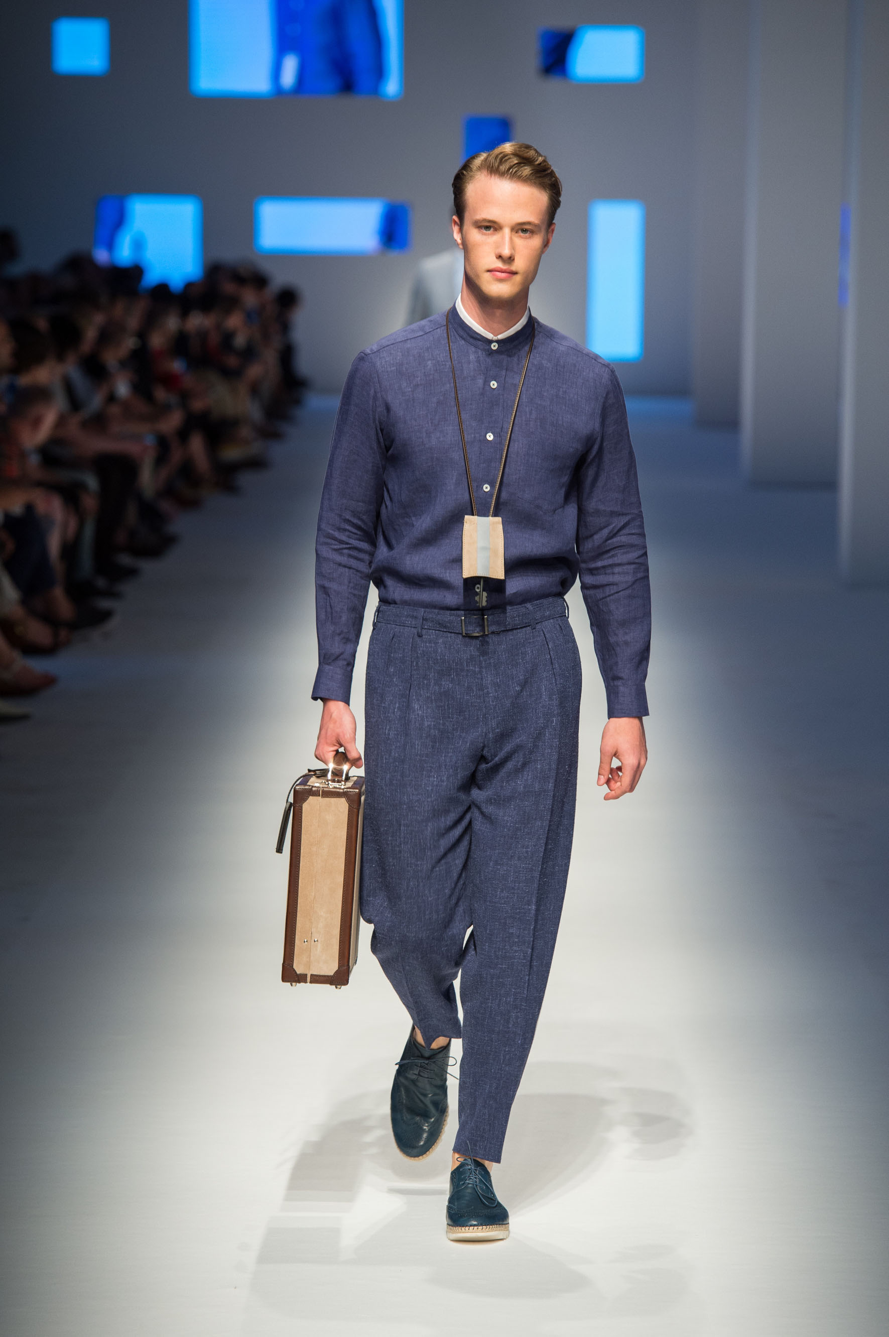 Indigo wool dress shirt, terry effect pants in wool-linen-silk, calfskin lace-up espadrilles, briefcase with stripe