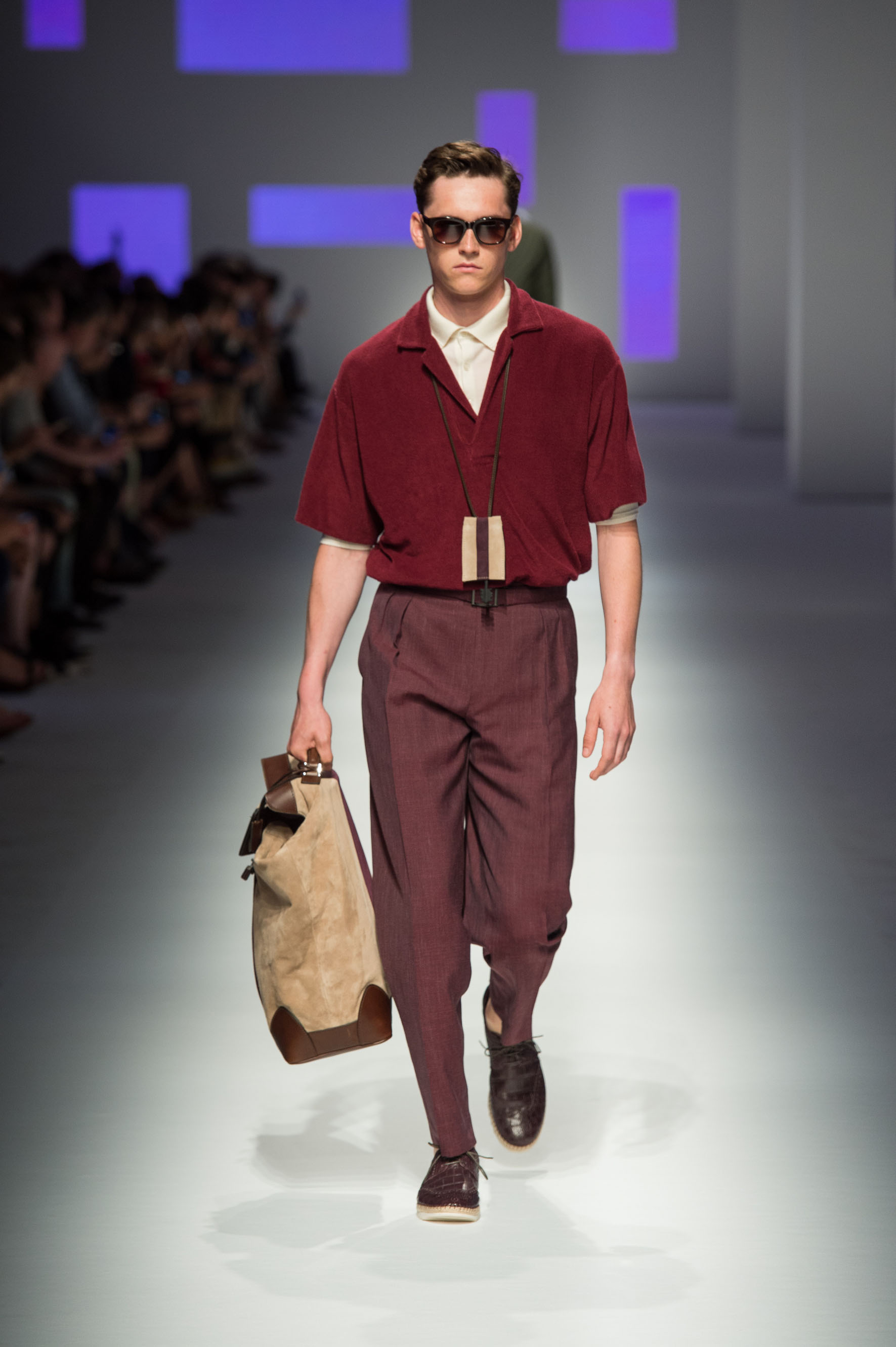 Pure cotton polo with terry effect, reverse-pleated pants with belt, crocodile espadrilles and suede holdall with stripe