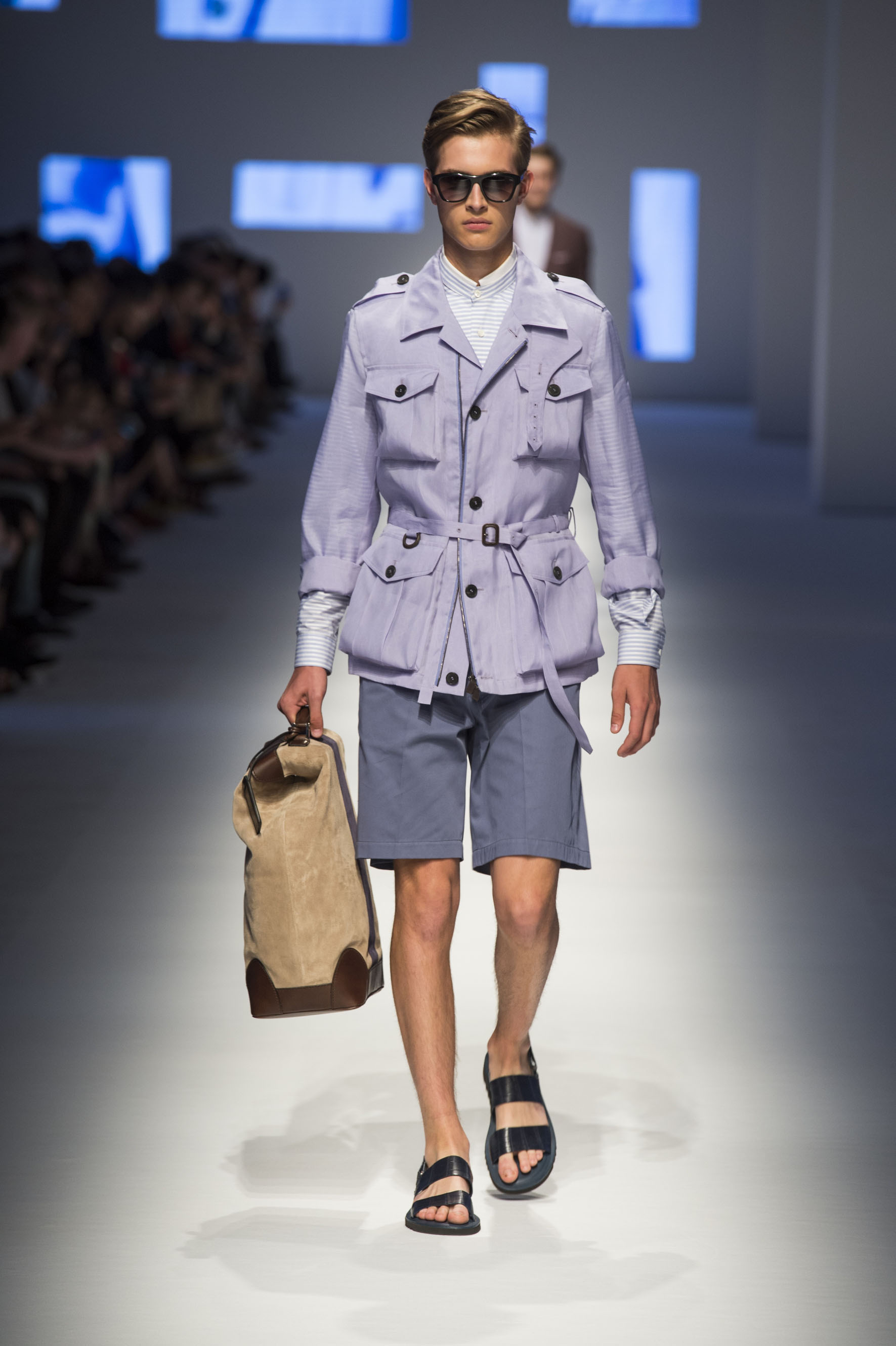 Pure silk field jacket with applied pockets, shorts with removable belt, crocodile sandals and suede holdall with stripe