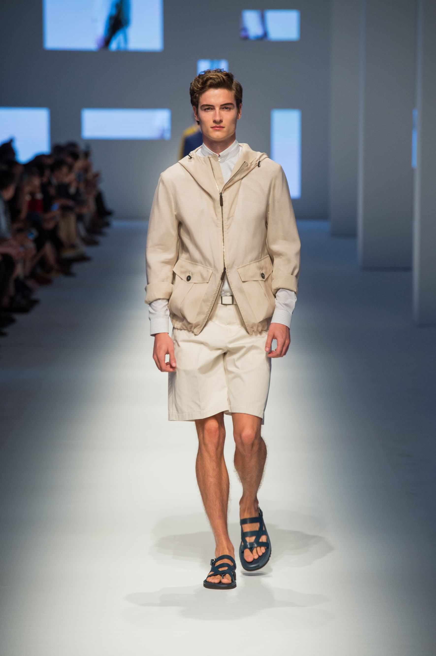 Jacket with fixed hood and bellows pockets, shorts with removable belt, double-layer dress shirt, calfskin sandals