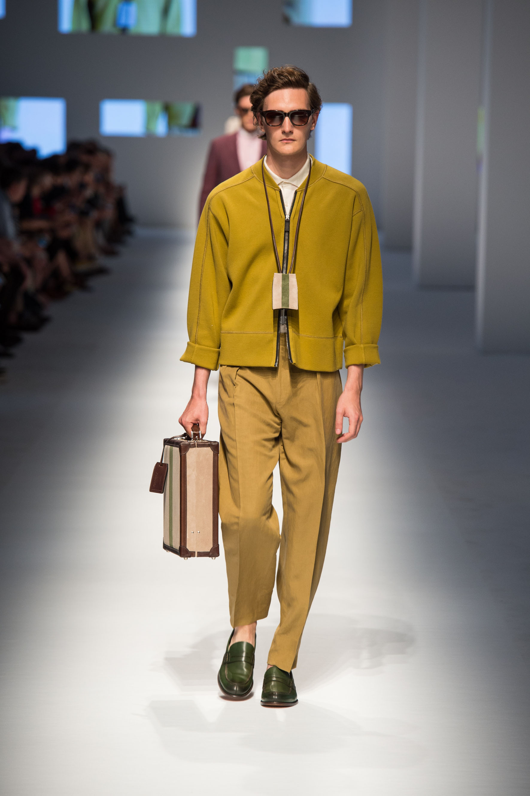 Pure cotton cardigan with zipper, cashmere-silk polo, reverse-pleated pants, calfskin loafers, briefcase with stripe