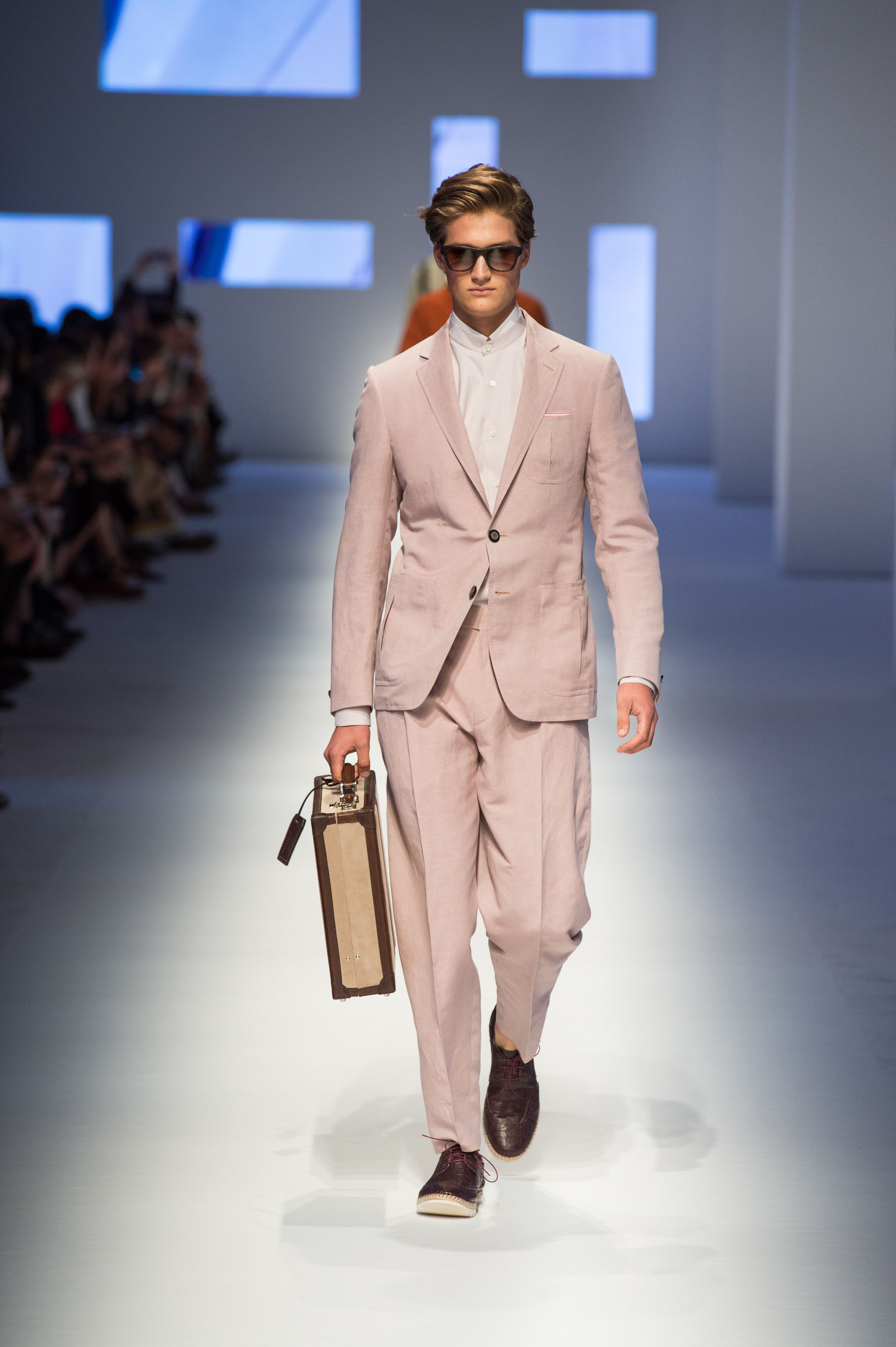 Two-button linen-silk jacket, reverse-pleated pants with belt, crocodile lace-up esapdrilles, briefcase with stripe
