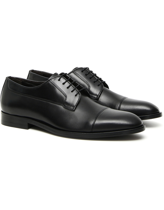 Black hand-buffed leather Derby shoes