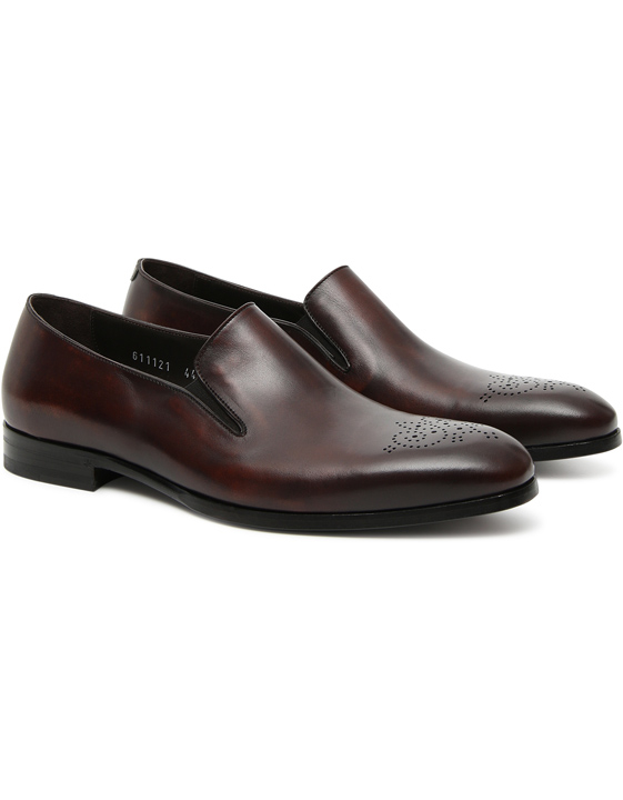 Brown leather loafers with medallion